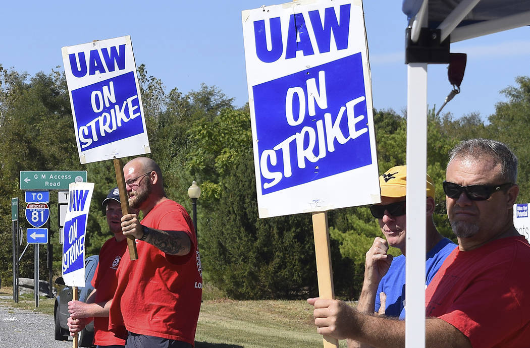 Members of United Auto Workers Local 1590 picket near the GM Martinsburg Parts Distribution Cen ...