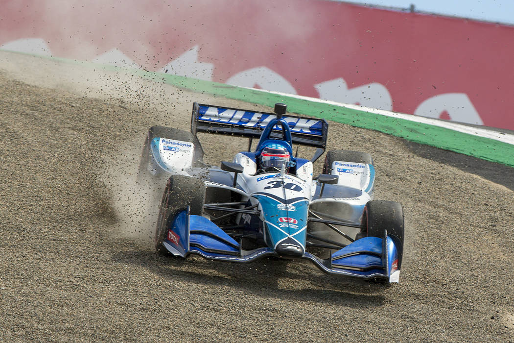 Takuma Sato (30) drives back onto the track after missing the turn at the top of The Corkscrew ...