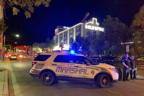 A large law enforcement presence is visible Thursday, Aug. 22, 2019, in downtown Las Vegas, at ...