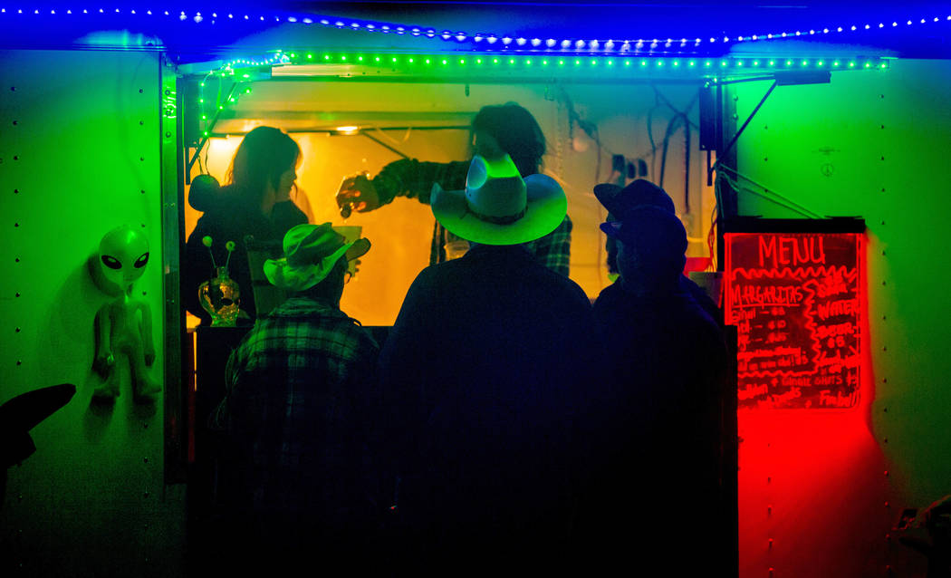 Festivalgoers stop by for a fresh margarita from Pioche vendors during the Alienstock festival ...