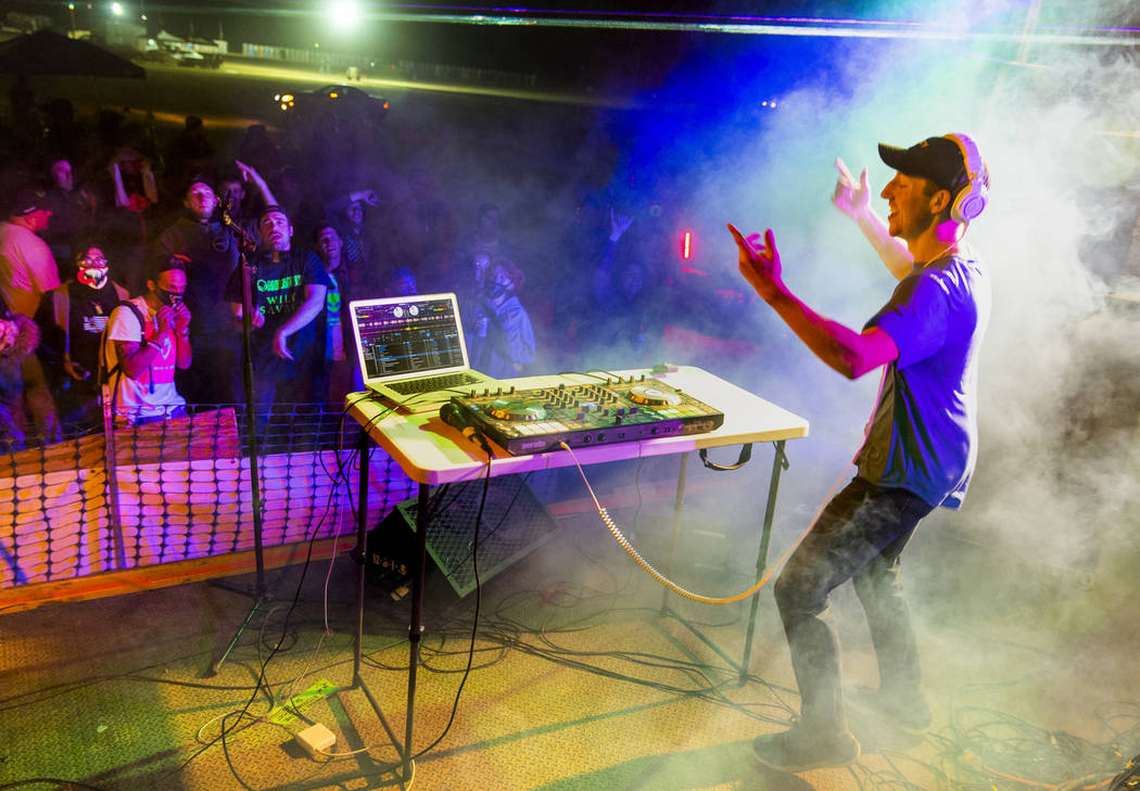 DJ Initiate performs before festivalgoers on the main stage during the Alienstock festival on S ...