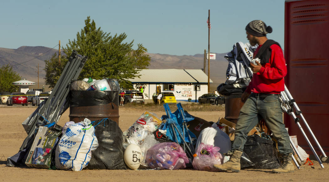 Trash is orderly stacked in the parking area across from the Little A'Le'Inn as festivalgoers d ...