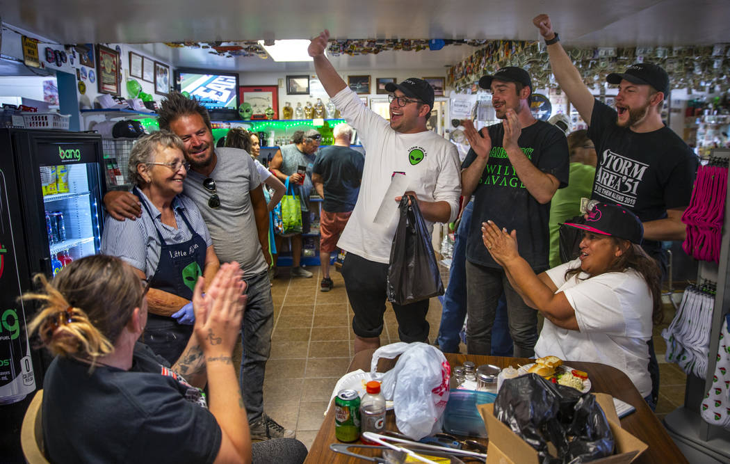 Pat Travis of the Little A'Le'Inn, left, is applauded by supporters and her daughter Connie Wes ...