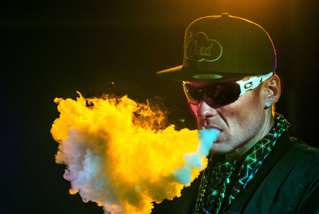 DJ Karn Elofson of Sweden controls the laser light show for performers on the main stage during ...
