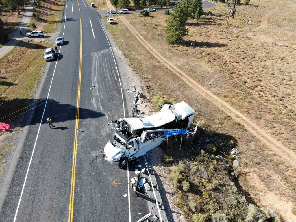 This photo shows a tour bus carrying Chinese-speaking tourists after it crashed near Bryce Cany ...