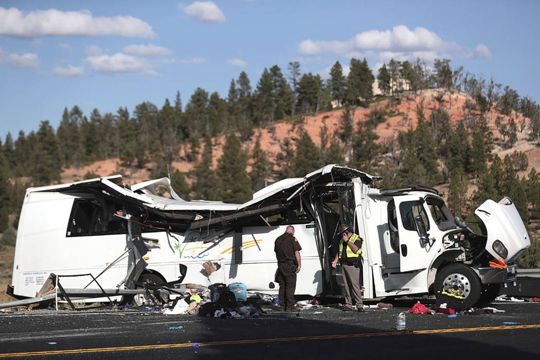 Authorities work the scene where at least four people were killed in a tour bus crash near Bryc ...