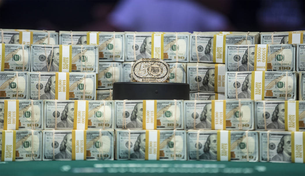 Stacks of cash are displayed on the table during the World Series of Poker Main Event on Tuesda ...
