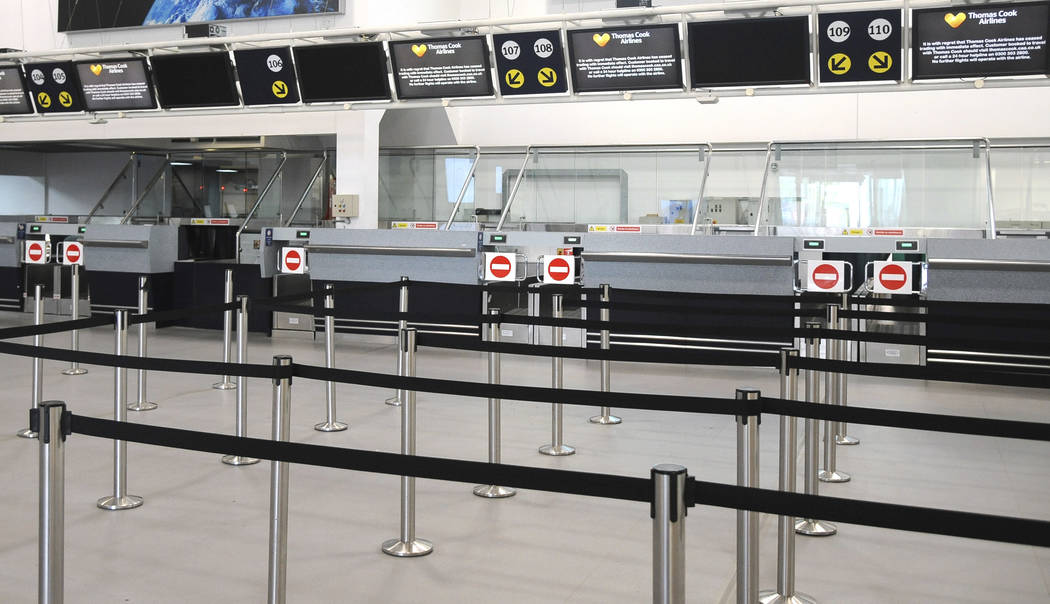 General view of the deserted Thomas Cook check-in counters at Birmingham airport in Birmingham, ...
