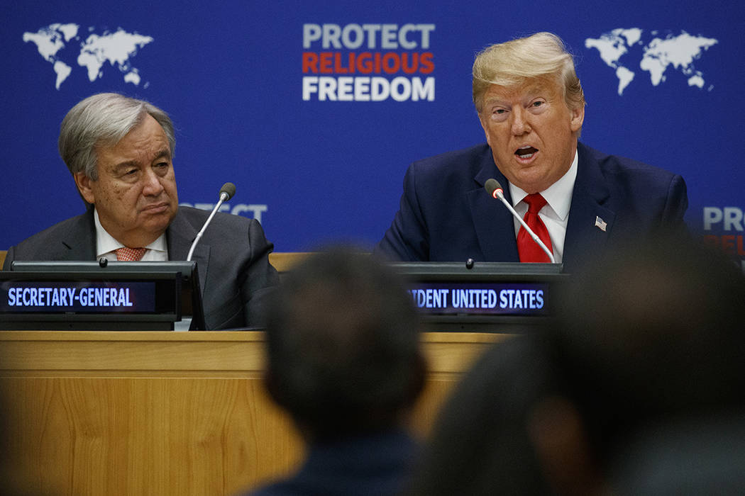 United Nations Secretary General Antonio Guterres listens as President Donald Trump speaks at a ...