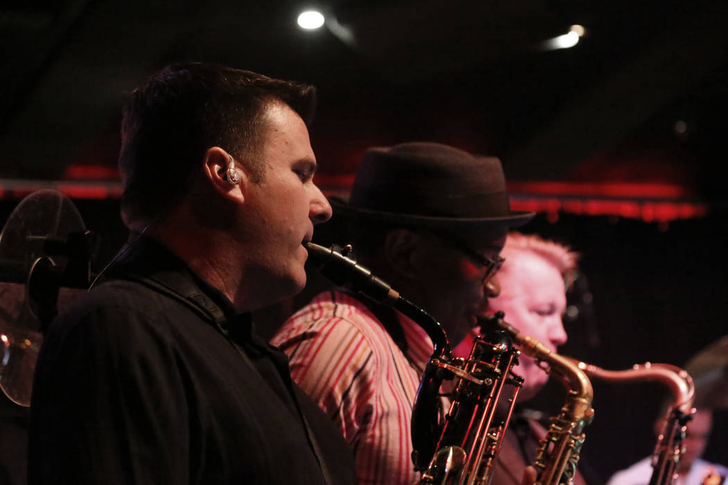 Eric Tewalt, member of the Santa Fe & The Fat City Horns, performs at the Copa Room in Las ...
