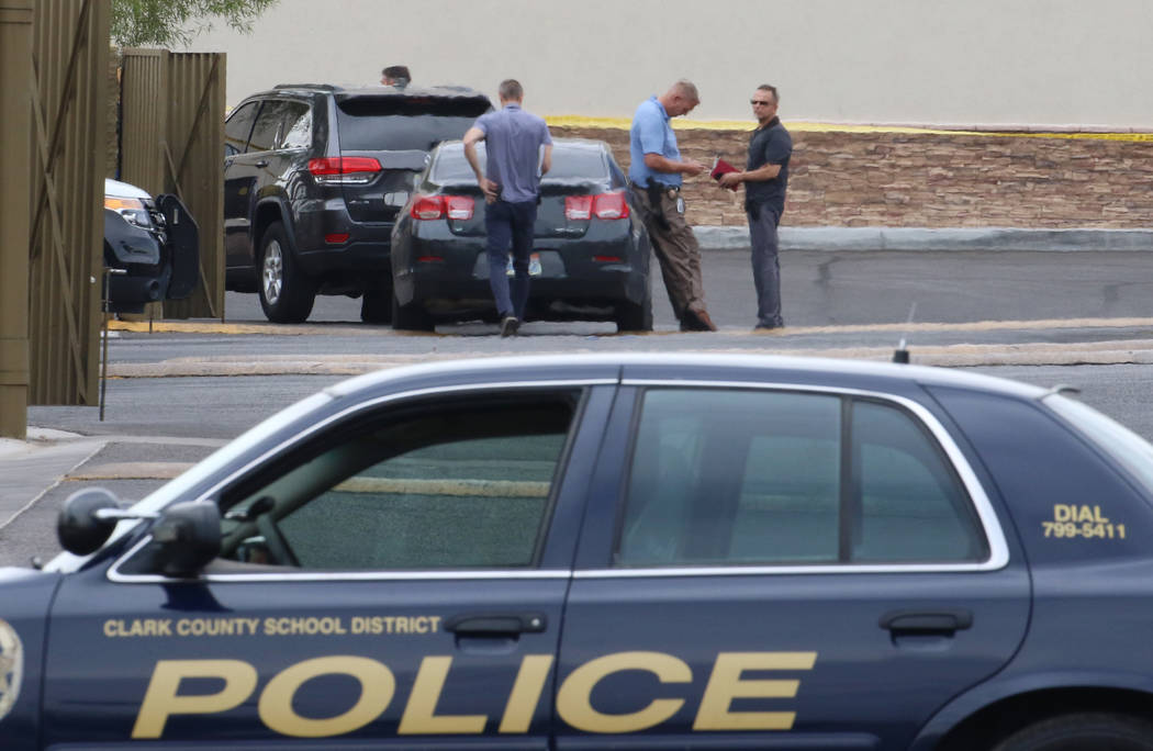 Las Vegas police blocked off part of Rainbow Boulevard at Robindale Road as they responded to a ...