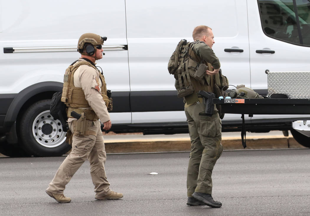 Metro SWAT unit arrive where Las Vegas police responded to an attempted robbery that turned int ...