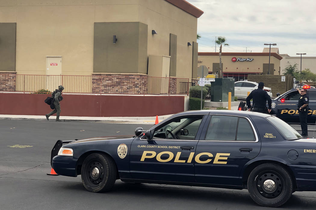 Police respond to a robbery that turned into a barricade situation at the 7700 block of South R ...