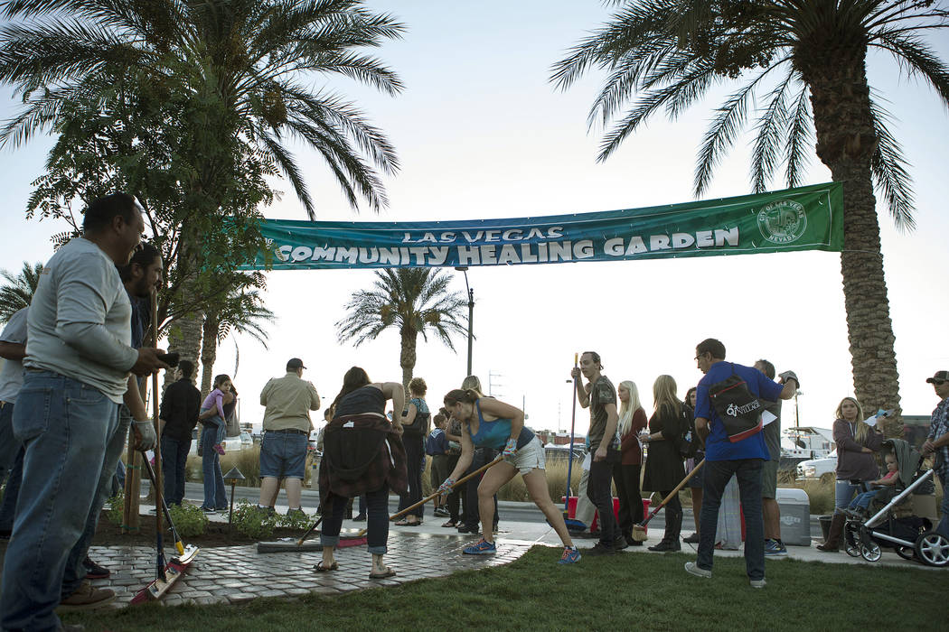 People prepare the Community Healing Garden in Las Vegas, Friday, Oct. 6, 2017. The city of Las ...