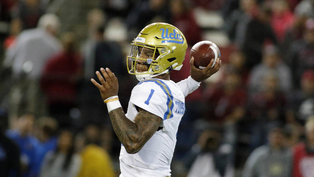 UCLA quarterback Dorian Thompson-Robinson (1) throws a pass during the second half of an NCAA c ...