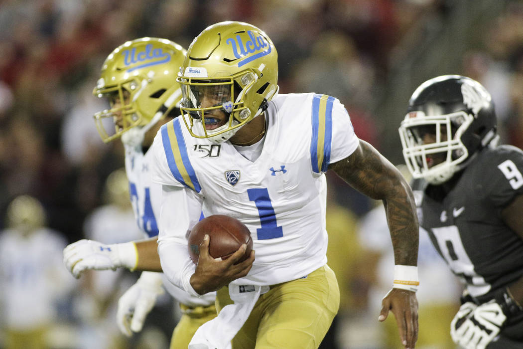 UCLA quarterback Dorian Thompson-Robinson (1) runs with the ball during the second half of an N ...