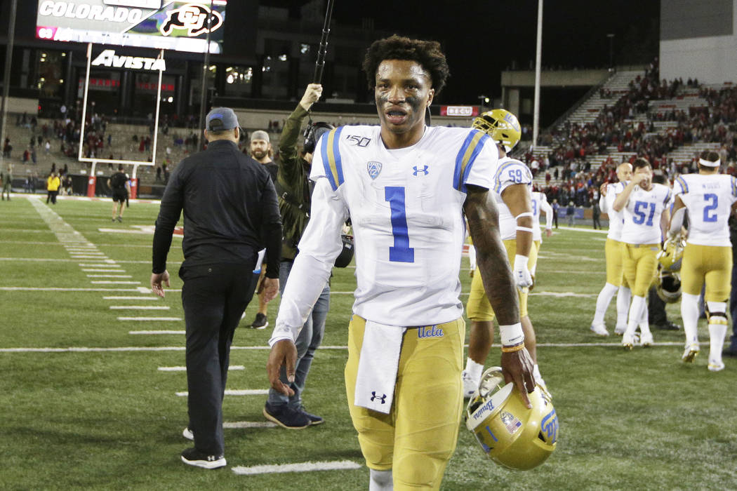 UCLA quarterback Dorian Thompson-Robinson (1) walks off the field after an NCAA college footbal ...