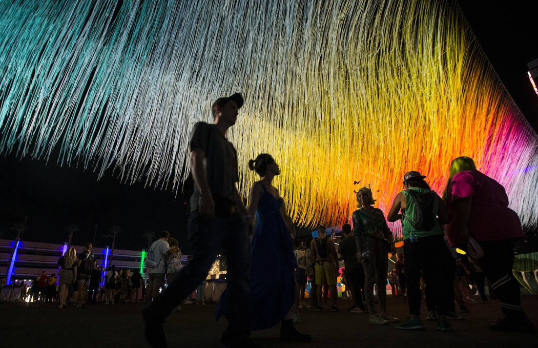 Attendees pass by an art installation by Hot Tea during the first day of the Life is Beautiful ...