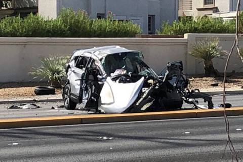 Police investigate a fatal crash near West Cheyenne Avenue and Buffalo Drive in Las Vegas, Sund ...