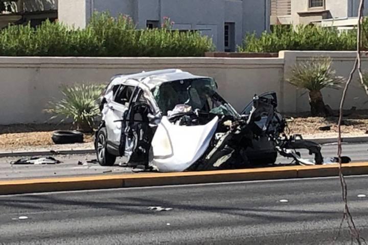 Police investigate a fatal crash near West Cheyenne Avenue and Buffalo Drive in Las Vegas, Sund ...
