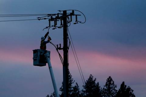 In a Nov. 26, 2018, file photo, a Pacific Gas & Electric lineman works to repair a power line i ...