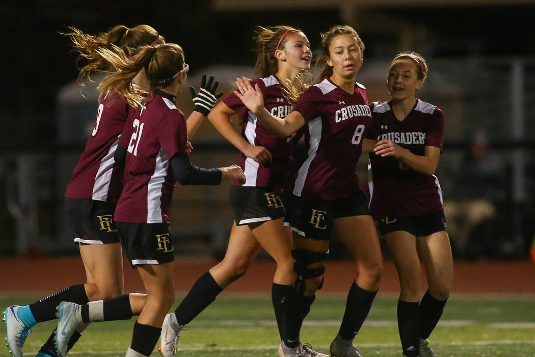 Faith Lutheran celebrates after scoring against Coronado during the state quarterfinal game at ...