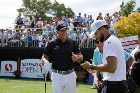 Phil Mickelson, left, talks with Stephen Curry on the first tee of the Silverado Resort North C ...