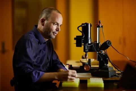 UNLV paleoclimatologist Matthew Lachniet studies the geologic record in stalagmites—the ...