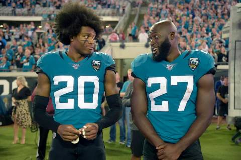 Jacksonville Jaguars cornerback Jalen Ramsey (20) talks to running back Leonard Fournette (27) ...