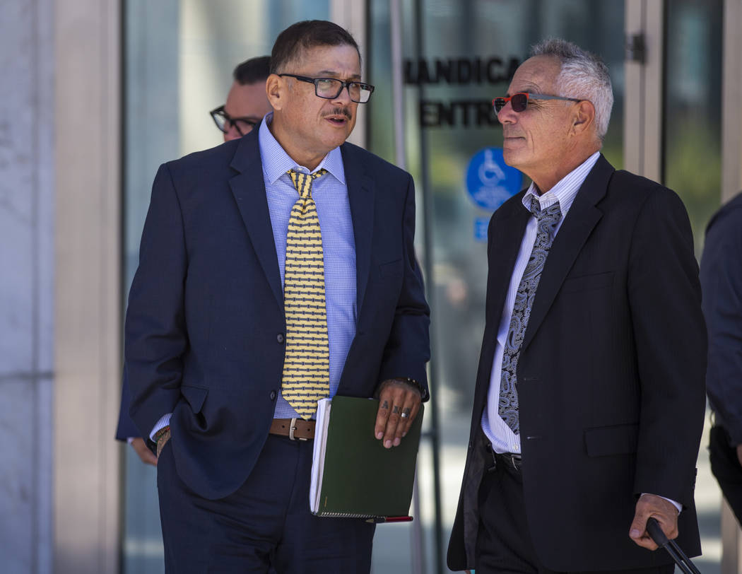 Defendant Cesar Morales, left, talks with counselor Shawn Perez outside the Lloyd D. George Cou ...