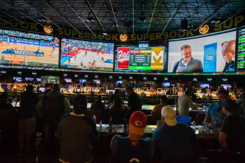 Basketball fans take in the first day of the NCAA Tournament at the Westgate Sportsbook on Thur ...