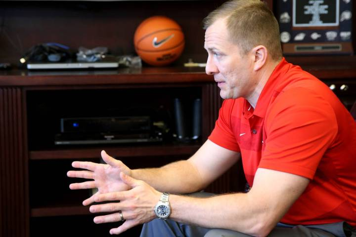 New UNLV basketball coach T.J. Otzelberger talks to a reporter in his office at the Thomas &amp ...