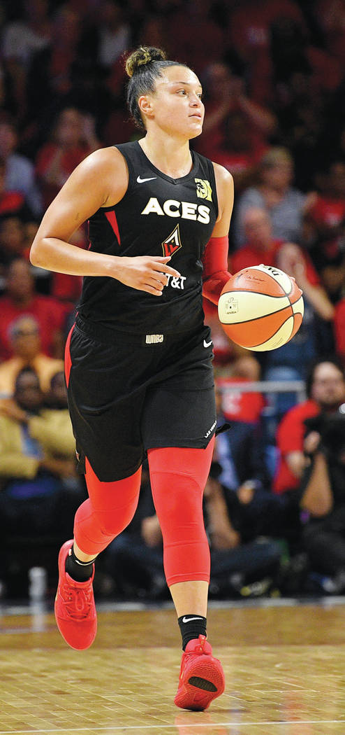 Las Vegas Aces guard Kayla McBride dribbles the ball during the second half of Game 1 of a WNBA ...