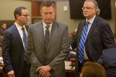 Scott Gragson, center, walks out of court with his attorneys Richard Schonfeld, left, and David ...