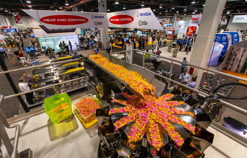 Product is processed by a Heat and Control FastBack horizontal motion conveyor on display at PA ...