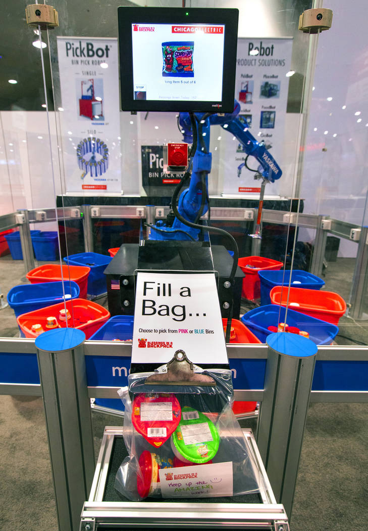 A robot from Chicago Electric packs school lunches for kids through Blessings in a Backpack at ...