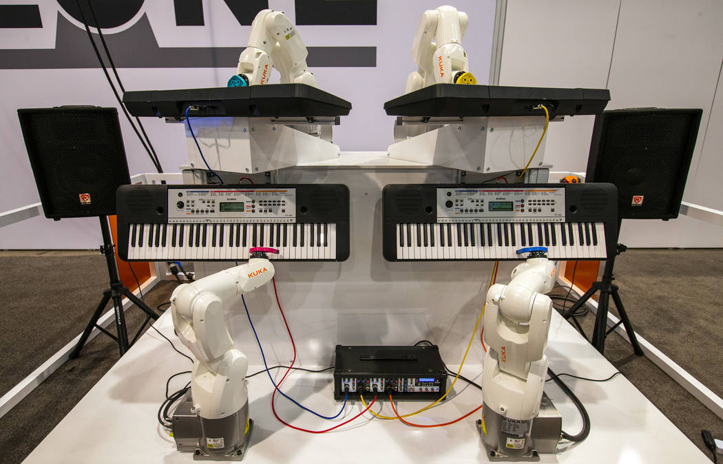 A Kuka Robot Band from ProMach Performance Services play pianos for attendees at PACK EXPO on M ...