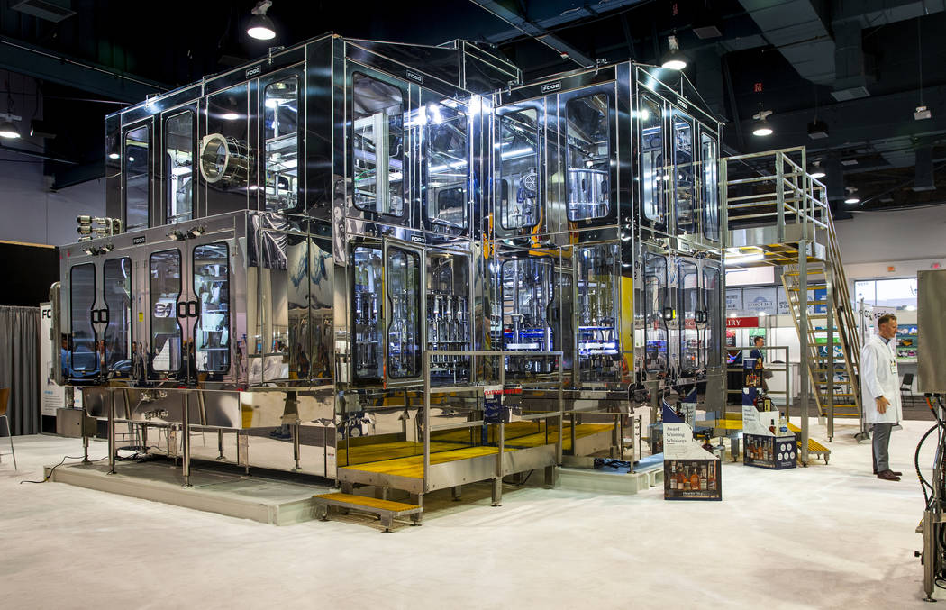 A massive Fogg Non-Contact filling machine is one of many on display at PACK EXPO on Monday, S ...