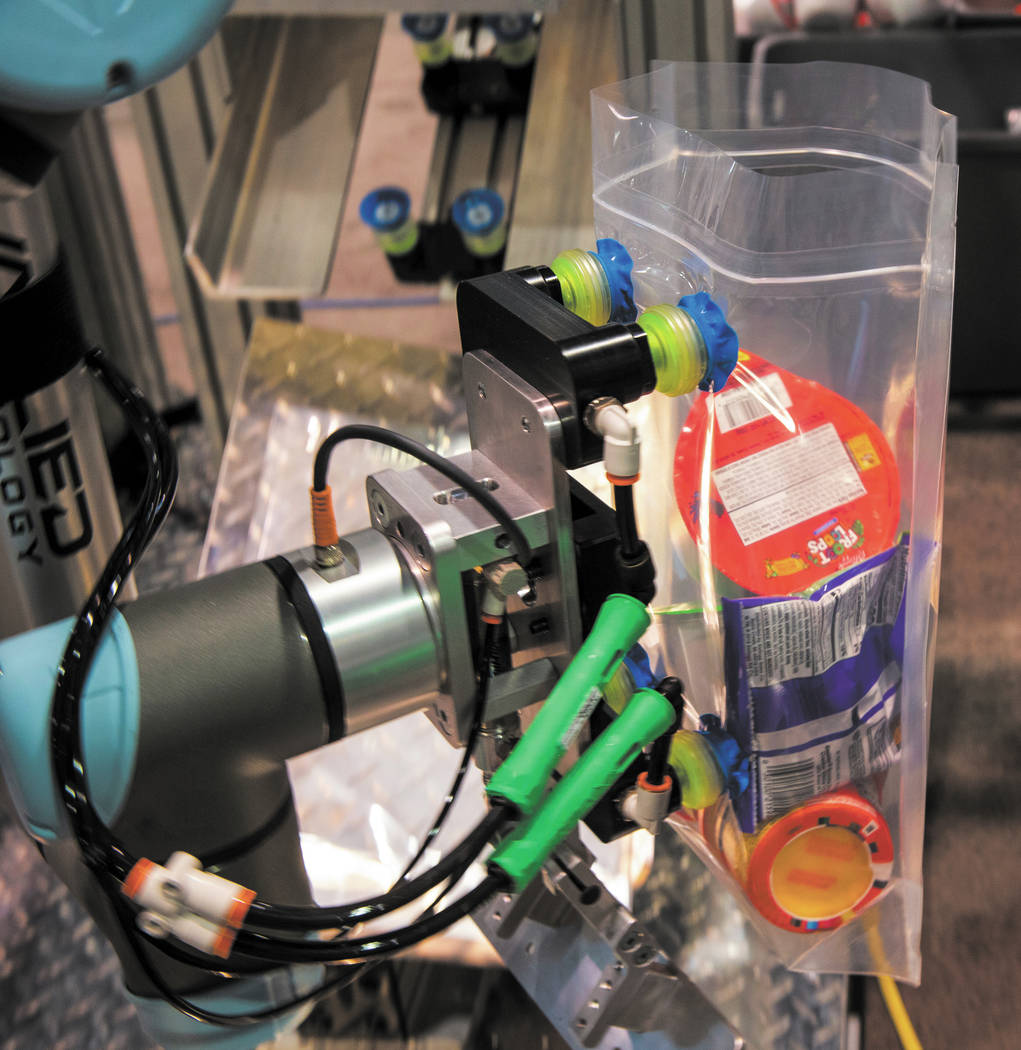 Robots from Allied Technology and Universal Robots are packing school lunches for kids through ...