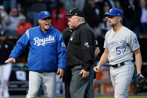 Kansas City Royals manager Ned Yost, left, appeals to umpire crew chief Bill Miller, center, af ...