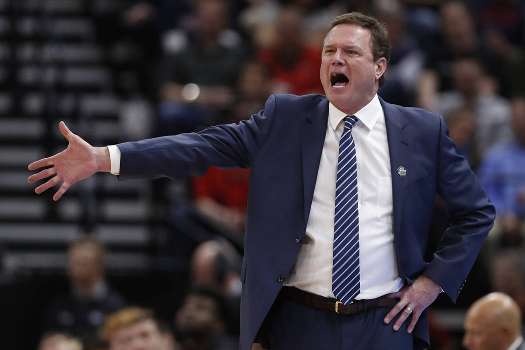 FILE - In this March 21, 2019, file photo, Kansas head coach Bill Self reacts in the first half ...