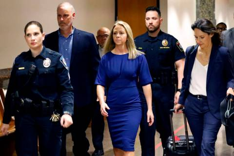 Former Dallas police officer Amber Guyger, center, arrives for the first day of her murder tria ...