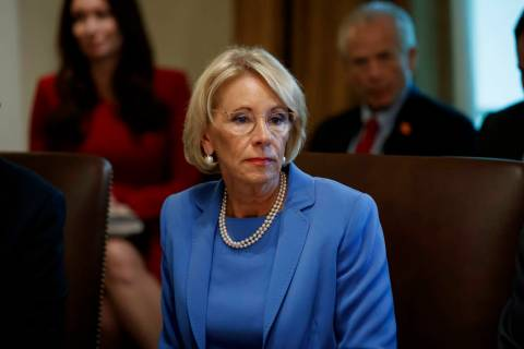 FILE - In this July 16, 2019, file photo, Education Secretary Betsy DeVos listens during a Cabi ...