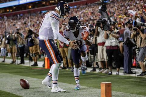 Chicago Bears quarterback Mitchell Trubisky, left, celebrates after connecting with wide receiv ...