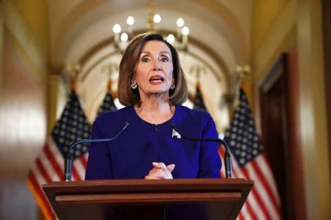 House Speaker Nancy Pelosi of Calif., reads a statement announcing a formal impeachment inquiry ...