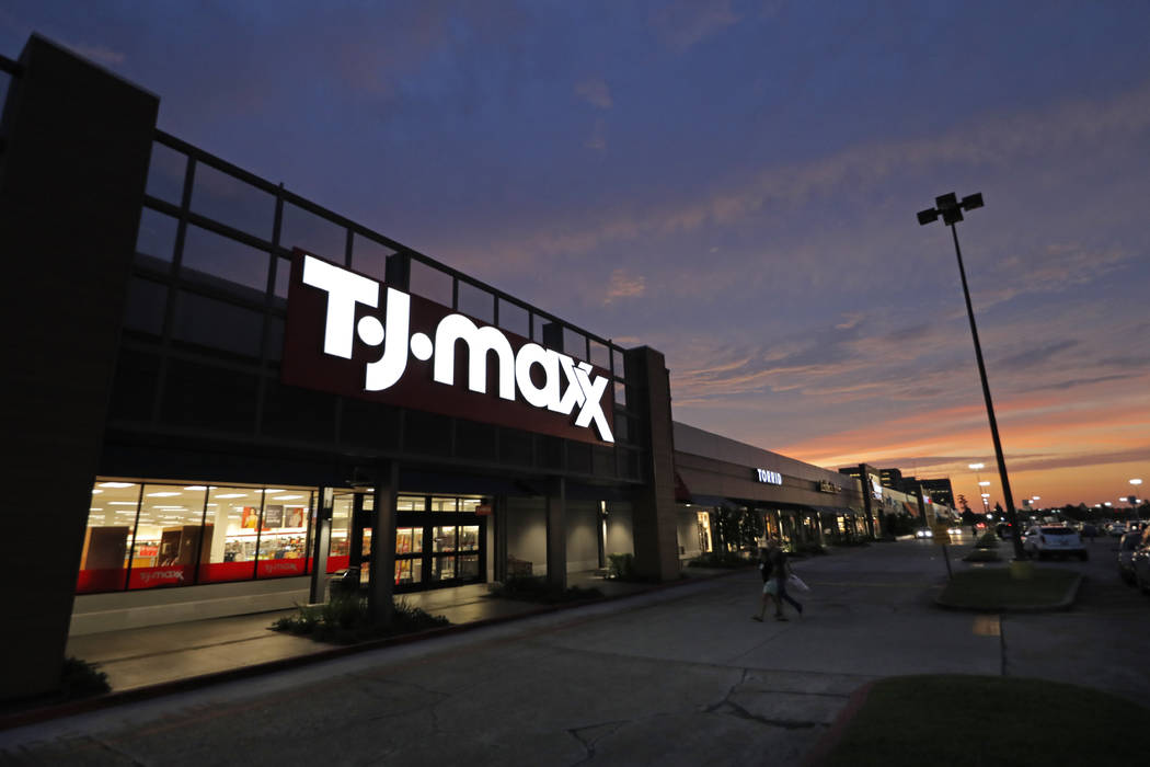 In an Aug. 15, 2019, photo shoppers enter a T.J. Maxx in Harahan, La.. On Tuesday, Sept. 24, th ...