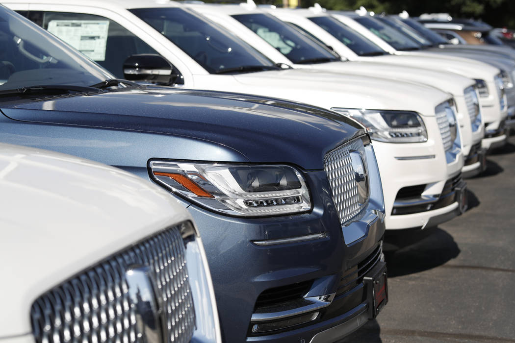 In a July 28, 2019, file photo unsold 2019 Lincoln Navigators sit at a dealership in Englewood, ...