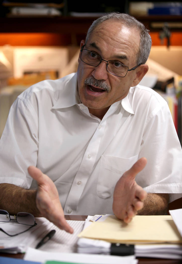 John Vellardita, executive director of the Clark County Education Association, talks to a repor ...
