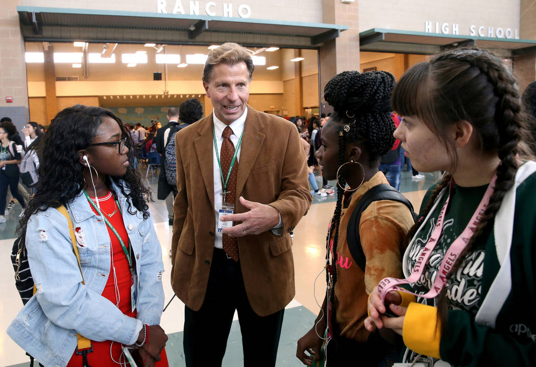 Principal James Kuzma visits with Davida Tyson, from left, Jantanazia Robinson and Malia Simons ...