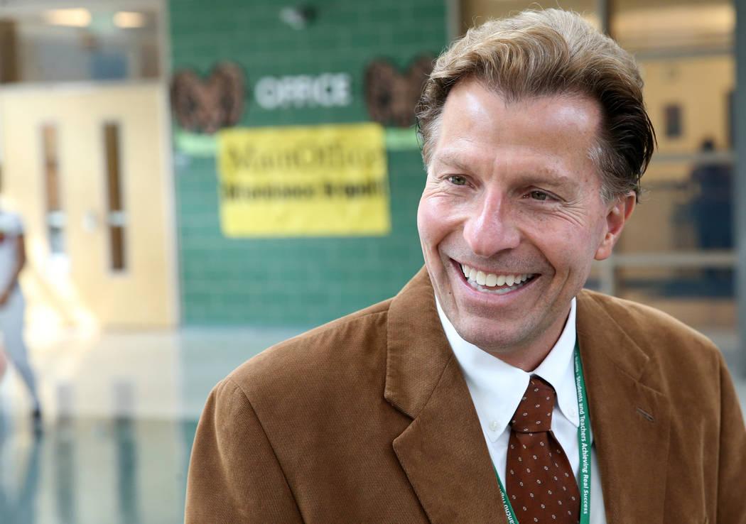 Principal James Kuzma talks to a reporter at Rancho High School in North Las Vegas, Thursday, S ...